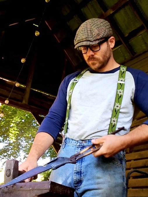 Photo of Steven Bryan forging a blade.